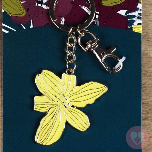 Πορτ κλε μεταλλικό με χρυσές λεπτομέρειες σε σχέδιο κίτρινου λουλουδιού