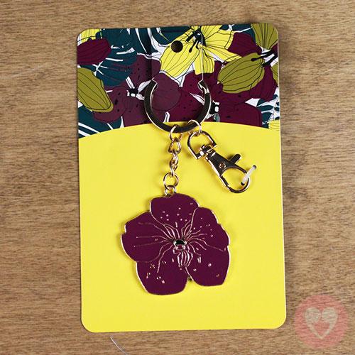 Πορτ κλε μεταλλικό με χρυσές λεπτομέρειες σε σχέδιο μωβ λουλουδιού